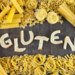 "The word ""gluten"" cutout of bread, surrounded by pasta: gluten and nasal congestion."