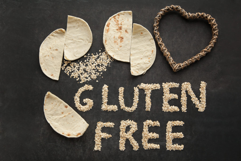 "The words ""gluten free"" surrounded by pita bread and flour: gluten and nasal congestion.l"