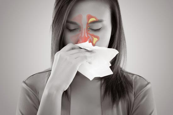 A woman experiences sinus discomfort which may indicate a need for balloon sinus balloon surgery.