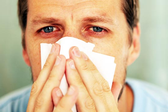 A man experiences discomfort related to a chronic sinus infection.