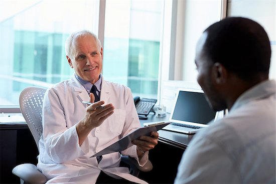 After conducting an online search a patient visits his doctor to discuss treatment options.