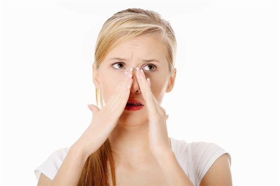 A woman is pained by her sinus infection which could be managed by balloon sinuplasty procedure.